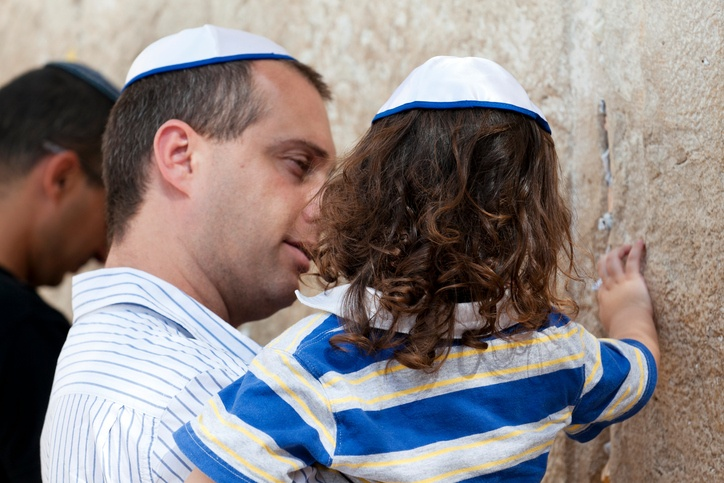 Jewish father and daughter pray at the Wailing Wall in Jerusalem, Israel.