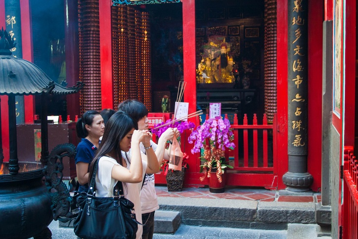People praying in Mengjia Longshan Temple in Taipei, Taiwan