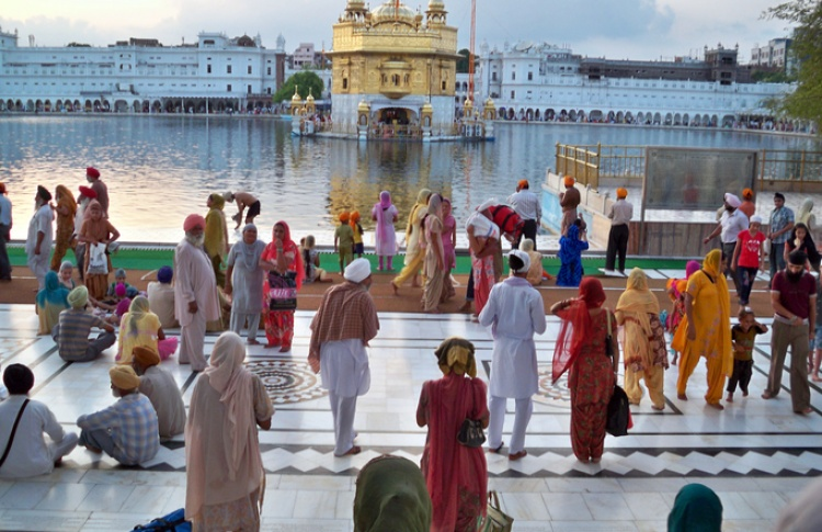 Pilgrims praying at the Pool of the Nectar of Immortality and Golden Temple