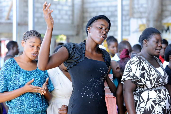 Christian women worship at a church in Bois Neus, Haiti.